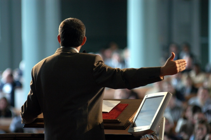 Man Speaking From Podium Stock Photo | Getty Images